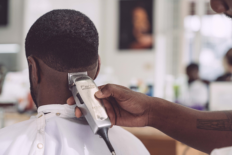 Clipper trim in a barbershop pre-Covid lockdown in England