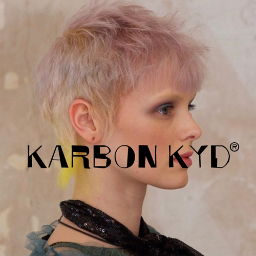 Karbon Kyd yellow and grey pixie cut