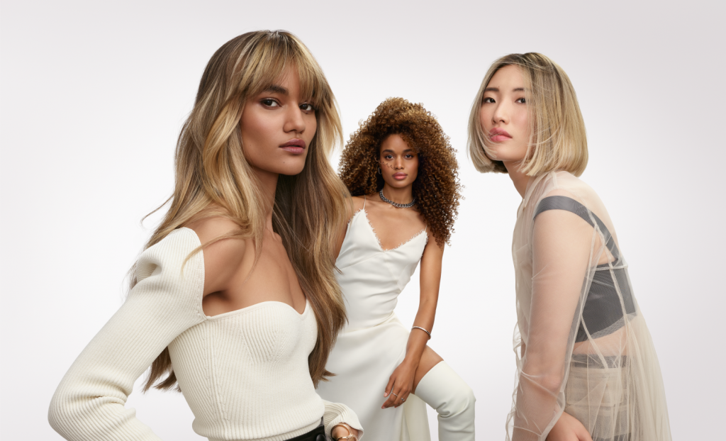 Blonde Unlocked partner L'Oréal Professionnel Paris's campaign image showing a trio of models with blonde hair coloured using the French Balayage technique