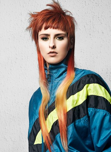 A disconnected style with rust red to yellow ombre, from the collection 'Clique' by Ciaran Dowd