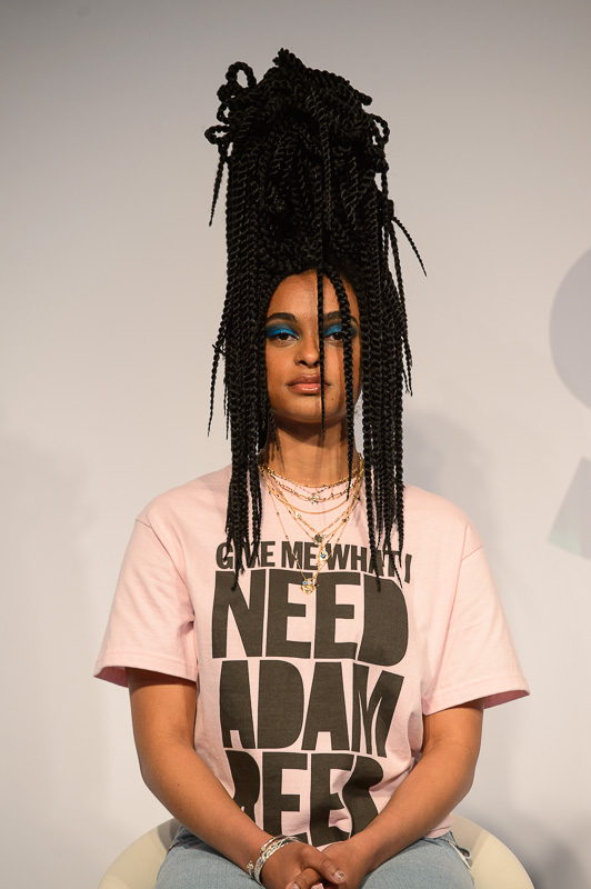 a hair model, styled by Adam Reed, with long braids in a towering bun on stage at Creative HEAD Magazine's Salon Smart Live 2021