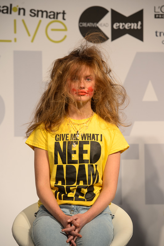 A hair model with dishevelled hair by Adam Reed on stage at Creative HEAD Magazine's Salon Smart Live 2021