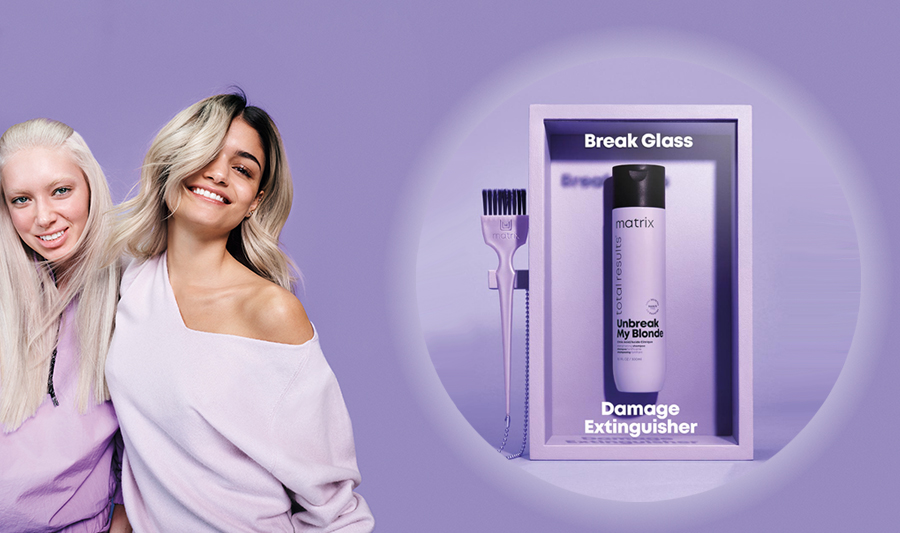 Matrix Unbreak My Blonde, pair of campaign models and conditioner product in a 'damage extinguisher' case