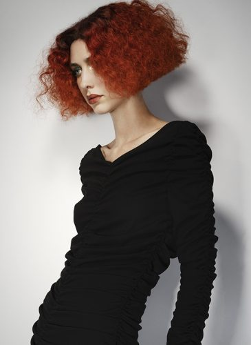 A vibrant red wavy bob from the 'Freak Out' collection by Pierre Ginsburg