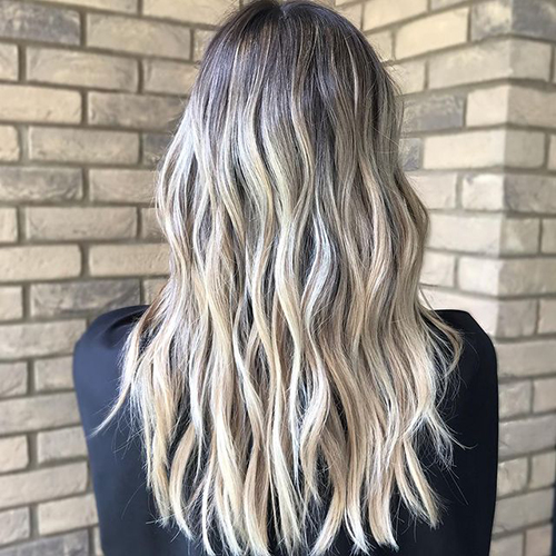 A blonde balayage look by Mary Forester, shown from behind.