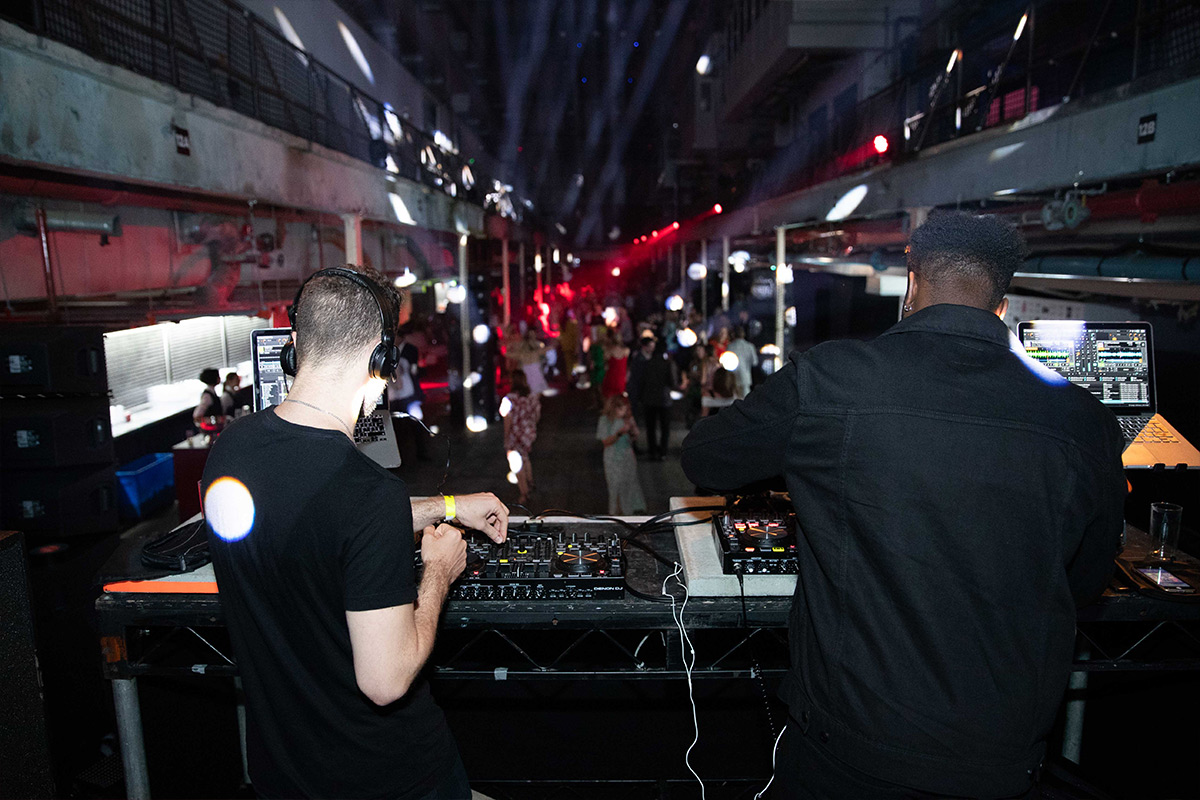 Behind the DJ booth