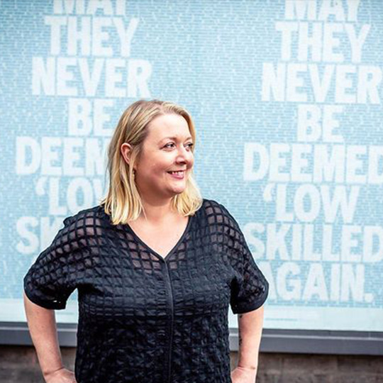 Hayley Jepson in front of positive affirmations