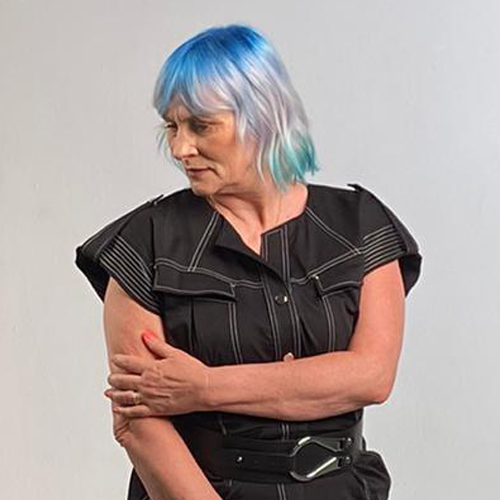 A model with hair in a bob style coloured with a blue gradient. Coloured by Jaymz Marsters at the Powered By Pulp Riot event