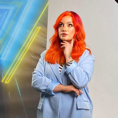 A model with long, vibrant orange hair. Coloured by Laura May Stevens at the Powered By Pulp Riot event