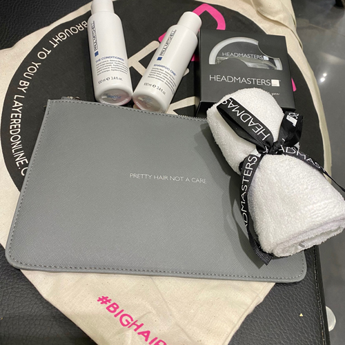 Big Hair Do 2021 goody bag featuring make-up bag, hair products and accessories