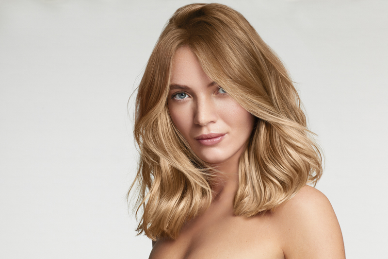 A white female model with blonde hair for Revlon Professional RE/START Density campaign