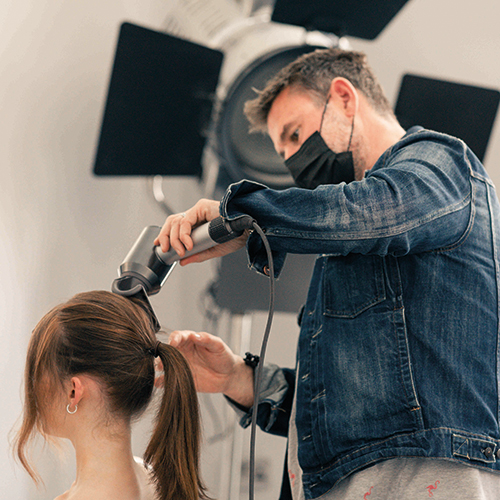 Hairdresser Dylan Bradshaw using the Dyson Supersonic professional hairdryer